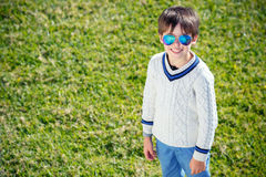 Cheerful little boy having relax outdoors Stock Photography
