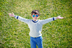 Cheerful little boy having relax outdoors Royalty Free Stock Photo