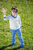 Cheerful little boy having relax outdoors Royalty Free Stock Photos