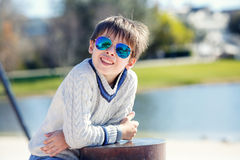 Cheerful little boy having relax outdoors Royalty Free Stock Image