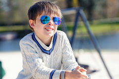 Cheerful little boy having relax outdoors Stock Photo