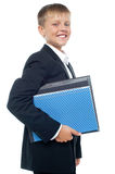 Cheerful little boy holding business files Royalty Free Stock Photo