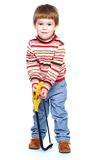 Cheerful little boy holding a hacksaw Stock Photos