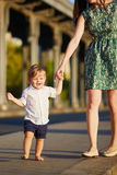 Cheerful little boy making his first steps Royalty Free Stock Photography