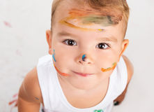 Cheerful little boy with painted face Stock Image