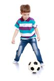 The cheerful little boy playing football Stock Photography