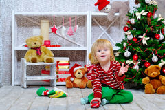 Cheerful little boy playing with his red toy car Royalty Free Stock Images