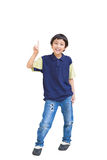Cheerful little boy pointing up Stock Images