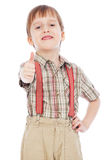 Cheerful little boy showing thumbs up stock image