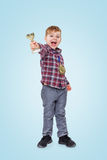 Cheerful little boy showing trophy cup. Happy little boy showing trophy cup and wearing golden medal on his chest over blue background stock photography