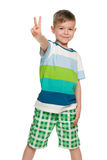 Cheerful little boy shows victory sign Stock Images