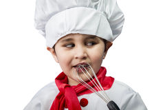 The cheerful little boy in a suit of the cook Royalty Free Stock Photos