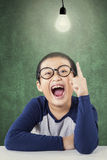 Cheerful little boy under lamp Stock Photography
