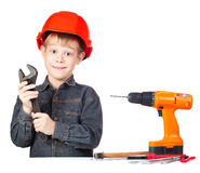 Cheerful little boy with wrench and screwdriver Royalty Free Stock Image
