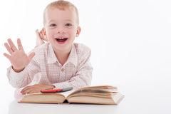 Cheerful little child is choosing new equipment Royalty Free Stock Photos