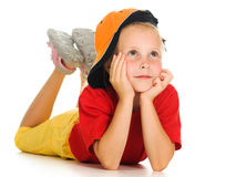 A cheerful little child with funny cap is lying Royalty Free Stock Photo