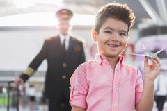 Joyful smiling small boy in airport Stock Photography