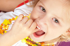 Cheerful little girl. Close-up Stock Images
