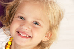 Cheerful little girl. Close-up Royalty Free Stock Photo