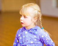 Cheerful little girl with blond pigtails Stock Images
