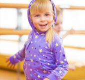Cheerful little girl with blond pigtails Royalty Free Stock Photos