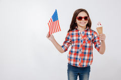 Cheerful little girl celebrating American national holiday stock images