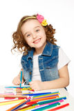 Cheerful little girl with felt-tip pen drawing in kindergarten Stock Photography
