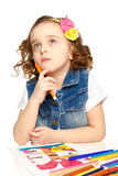 Cheerful little girl with felt-tip pen drawing in kindergarten Royalty Free Stock Image