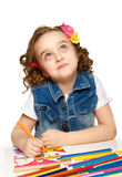 Cheerful little girl with felt-tip pen drawing in kindergarten Royalty Free Stock Photography