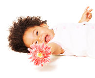 Cheerful little girl with a flower. Portrait of a little girl with a pink flower on white background stock photos