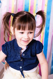 A cheerful little girl with funny tails Royalty Free Stock Photography