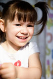 A cheerful little girl with funny tails Stock Photos
