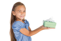 Cheerful little girl giving a present Royalty Free Stock Photography