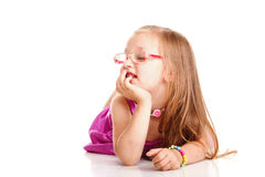 Cheerful little girl glasses funny is lying isolated Stock Photos