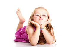 Cheerful little girl glasses funny is lying isolated stock photo
