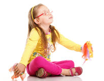 Cheerful little girl glasses funny and toy isolated royalty free stock photography