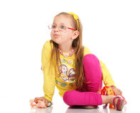 Cheerful little girl glasses funny and toy isolated Stock Photos