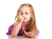 Cheerful little girl glasses to count is lying  Stock Photography