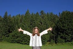 Cheerful little girl with hands up Royalty Free Stock Images