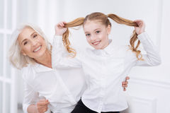 Cheerful little girl having fun with her grandmother Stock Photo