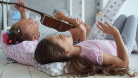 Cheerful little girl and her father singing a nice song stock video