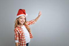 Cheerful little girl holdign the bell Stock Photography