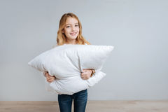 Cheerful little girl holding pillow Royalty Free Stock Images