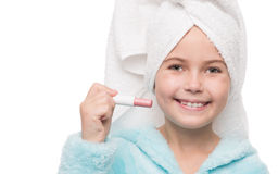 Cheerful little girl with hygienic lipstick Stock Photography
