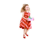 Cheerful little girl jumping with a gift Stock Image