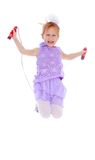 The cheerful little girl jumping skipping rope Stock Photo