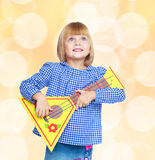 Cheerful little girl with the layout Stock Images