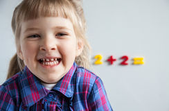 Cheerful little girl learning to count Stock Images