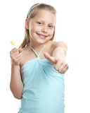 Cheerful little girl with lollipop Stock Image