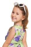 Cheerful little girl looks back Stock Photography
